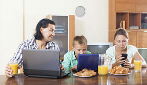 family using internet devices